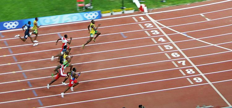 100m sprint Jamaica's usain bolt became the first olympian to win three straight 100-meter gold medals, overtaking american rival justin gatlin on.