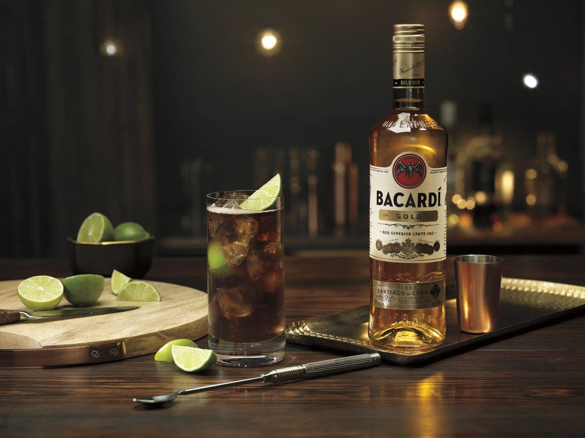Bacardi Gold Rum with Coke and lime wedges