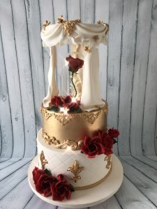 Gold and white tiered cake