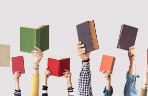 People holding books up