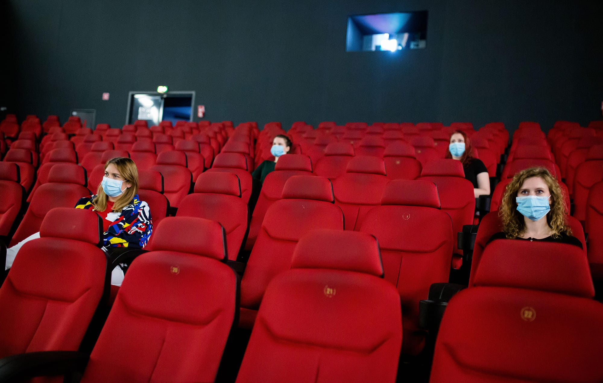 Customers have to keep their social distances in the cinema hall.