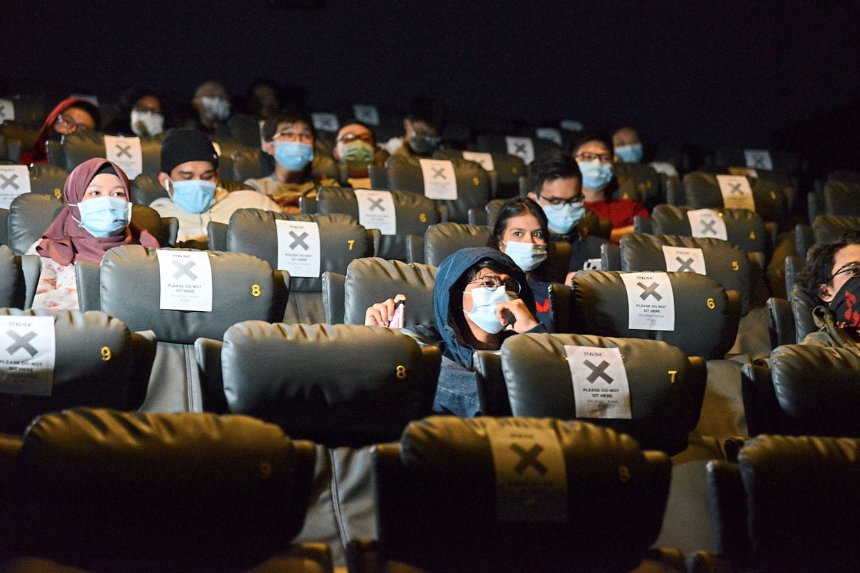 Wearing mask in the cinema is a new norm.